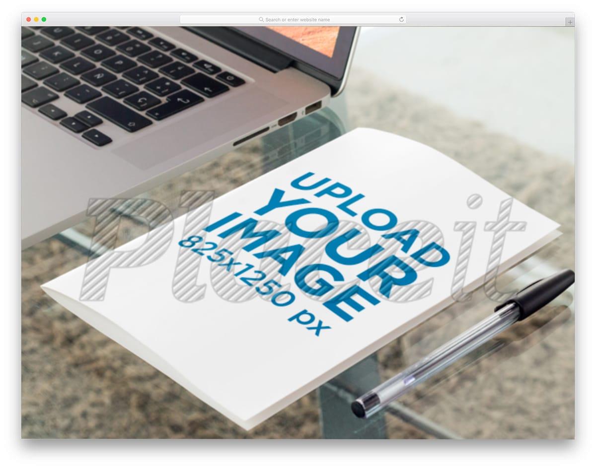 brochure on a glass table mockup image